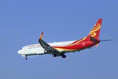 Atterrissage de Chang An Airlines Boeing 737-8FHWL dans Pékin, Chine Photo libre de droits
