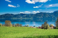 Attersee, Nussdorf. Meadows, lake Attersee and mountains seen from Nussdorf Royalty Free Stock Photography