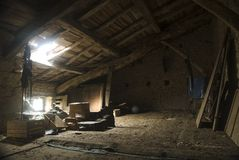 Attic. View from inside an abandoned house Royalty Free Stock Photos