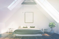 Attic bedroom with a gray bed, poster toned Royalty Free Stock Photo