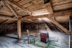 Attic in the destroyed building Royalty Free Stock Photo