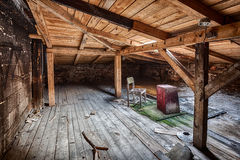 Attic in the destroyed building Royalty Free Stock Photography