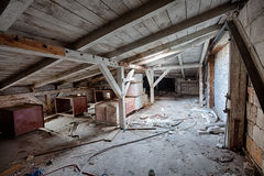 Attic in the destroyed building Royalty Free Stock Photos