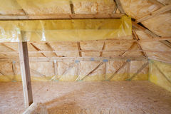 Attic with environmentally friendly and energy efficient thermal insulation rockwool.  stock image