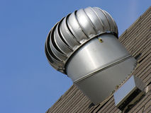 Attic exhaust vent. An attic exhaust vent on a shingle roof Stock Images