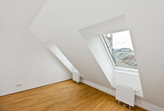 Attic flat with wooden floor Stock Photo