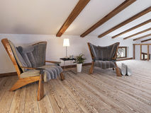 The attic floor with a seating area with designer chairs and a l Royalty Free Stock Photography