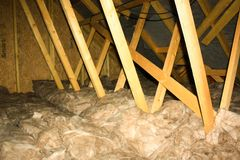 Attic Insulation. A view of attic insulation within a typical household stock image