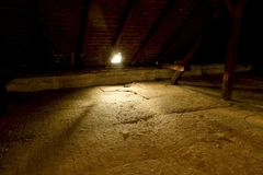 Attic loft insulation. Old loft. renovation and thermal insulation with mineral rock wool. royalty free stock photography
