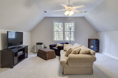 Attic man cave with tv Stock Images