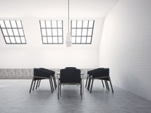 Attic meeting room interior black chairs side view. Attic white brick meeting room interior with a concrete floor and dark blue armchairs near a boardroom table Royalty Free Stock Images