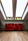 Attic with modern radiator Stock Photography
