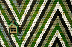 Attic and mosaic roof. Geometric mosaic ornament made of white, black, gray and green tiles together with small attic on roof of Saint Stephen�s Cathedral Stock Photography