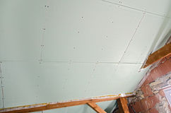 Attic with plasterboard under construction Royalty Free Stock Image