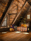 Attic with pumpkins and candles Royalty Free Stock Images