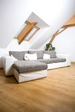 Attic room. White attic room with a sofa Royalty Free Stock Photos