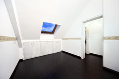 Attic room with roof skylight window royalty free stock photography