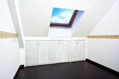 Attic room with roof skylight window Stock Photos