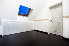 Attic room with roof skylight window Stock Photos