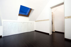 Attic room with roof skylight window Royalty Free Stock Images