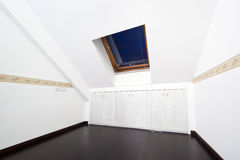 Attic room with roof skylight window Royalty Free Stock Image