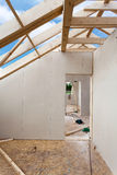 Attic room under construction with gypsum plaster boards. Roofing Construction Indoor. Wooden Roof Frame House Construction.  Stock Image