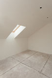 Attic room under construction with gypsum plaster boards and window. Stock Photo