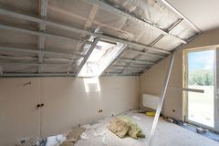 Free Attic Room Under Construction With Gypsum Plaster Boards And Windows. Royalty Free Stock Images - 105565009