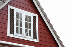 Attic with white wood window Stock Images