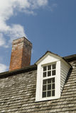 Attic Window. Close Up of A Dormer Window and Chimney Royalty Free Stock Image