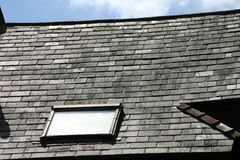 Attic Window. Window on Slate Roof royalty free stock image