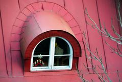 Attic window on the red roof of the old town stock photo