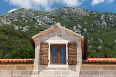 Attic window. Perast, Montenegro Royalty Free Stock Images