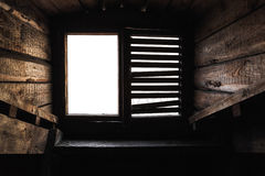 Attic window with shutters in old wooden interior Stock Image