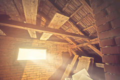 Attic window with sunrays Stock Photography