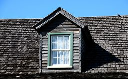 Attic window in tiled roof Royalty Free Stock Photos