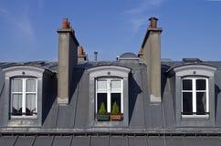 Attic windows in Paris. stock photography