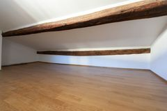 Attic with wooden beams and parquet stock photos