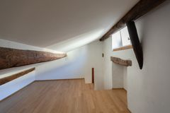 Attic with wooden beams and parquet stock photography