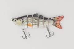 Attirails de pêche sur un fond blanc Photos stock