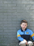 Attitude. Little boy against a brick wall with definite attitude stock photography