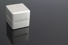 Attitude. Metallic cube paperweight with the word attitude engraved in the side Royalty Free Stock Photos