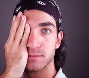 Attitude 4. Man covering an eye stock image