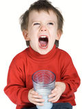 Attitude boy. Toddler with an attitude and milk moustach Royalty Free Stock Images