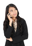 Attitude of a businesswoman. Who was holding the phone isolated on white background Stock Photos