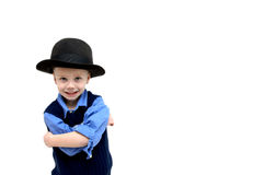Attitude comes with Hat. Cute little boy poses with an antique derby felt hat. His arms are crossed and he is sporting an attitude. Child poses in corner with Royalty Free Stock Image