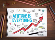 Attitude Is Everything, Business Concept. Notebooks, pen and colored pencils on a wooden table. vector illustration
