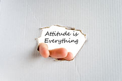 Attitude is Everything Concept. Hand and text on the cardboard background Attitude is Everything Concept Stock Photo