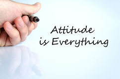 Attitude is Everything Concept. Pen in the hand  over white background Attitude is Everything concept Royalty Free Stock Images