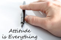 Attitude is Everything Concept. Pen in the hand  over white background Attitude is Everything concept Stock Photos